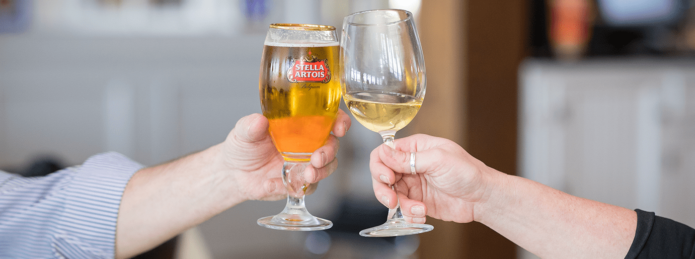 Beer and wine glass clinking for cheers