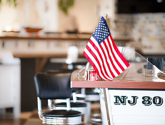 A small American flag on the bar in The Windlass